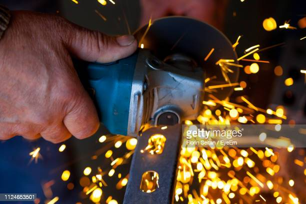 cropped image of worker cutting metal - florin seitan stock pictures, royalty-free photos & images
