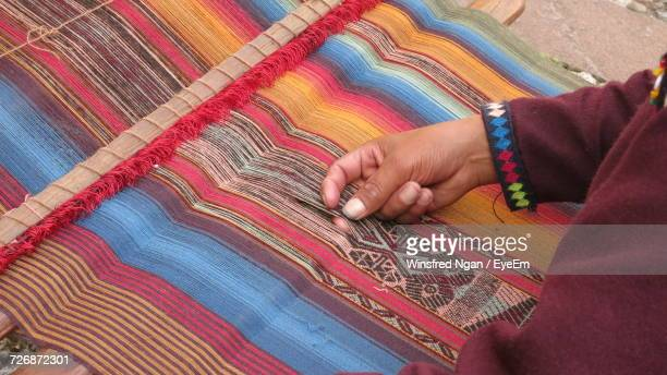 Cropped Image Of Worker Weaving Colorful Threads On Loom
