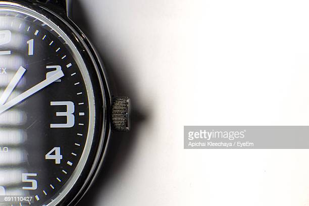 Cropped Image Of Wristwatch On White Background