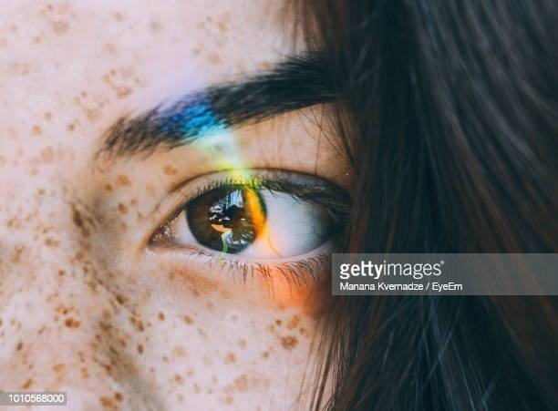cropped image of young woman eye - rainbow stock pictures, royalty-free photos & images