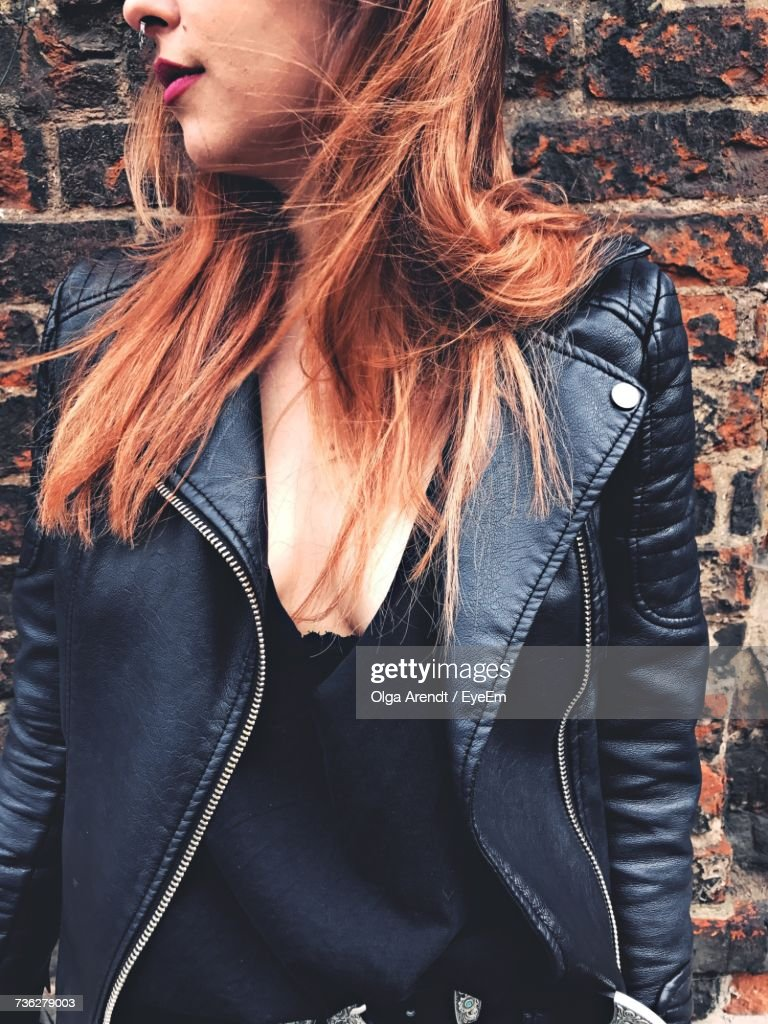 Cropped Image Of Young Woman Standing Against Wall : Stock Photo