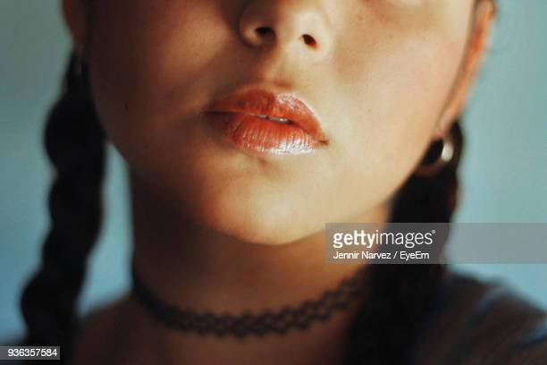 cropped image of young woman wearing choker - short necklace stock pictures, royalty-free photos & images