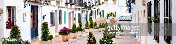 cropped image street of altea village in alicante, spain - altea stock photos and pictures