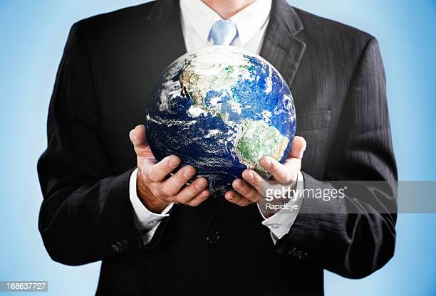 Cropped image with businessman holding satellite view of Earth