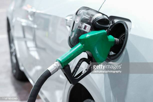 cropped of machine refueling car - gasoline stock pictures, royalty-free photos & images