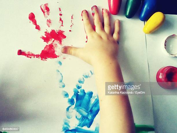 Cropped Painted Hand Of Child