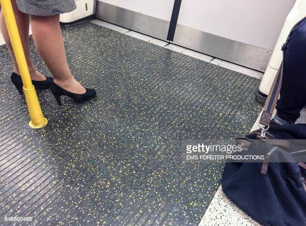 cropped people in london underground - ankle length stock pictures, royalty-free photos & images