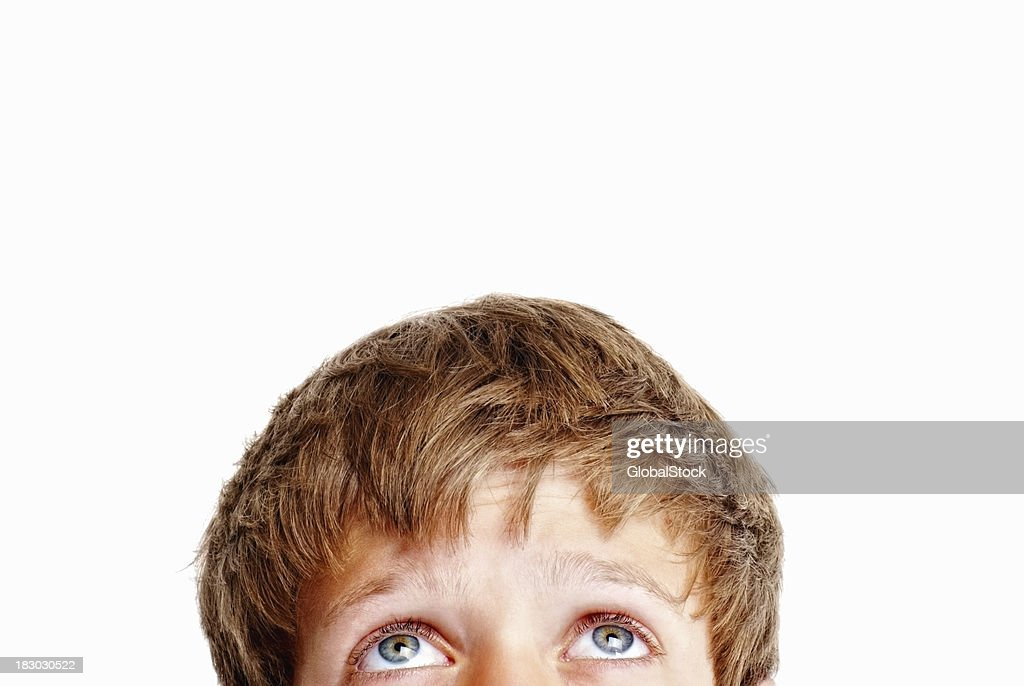 Cropped portrait of a blond boy staring at copyspace : Stock Photo