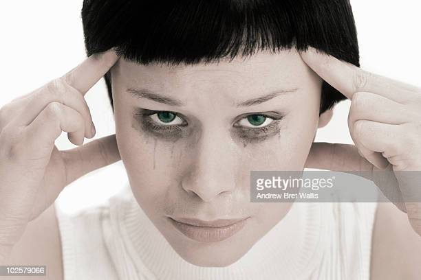 cropped portrait of a woman crying  - bad bangs stock pictures, royalty-free photos & images
