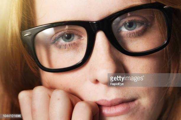 cropped portrait of serious young redhead in eyeglasses - horn rimmed glasses stock pictures, royalty-free photos & images