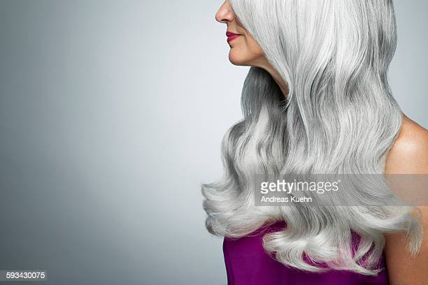 Cropped profile of a woman with long, gray hair.