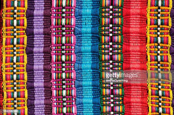 Cropped section of a Mexican blanket in bright colours