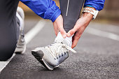 Cropped shot of a young man holding his ankle in pain sprain a foot.