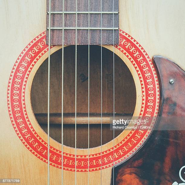 cropped shot of acoustic guitar - stringed instrument stock pictures, royalty-free photos & images