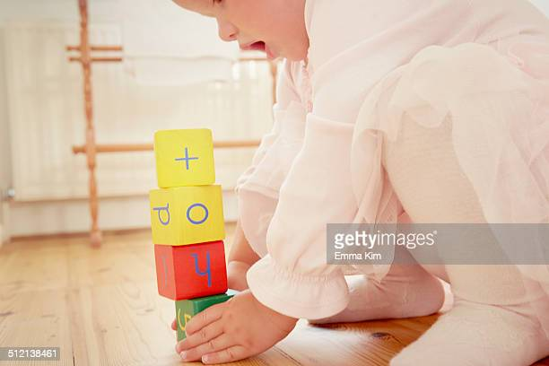Cropped shot of baby girl building stack with building blocks
