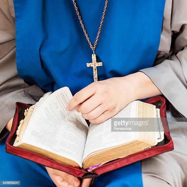 Cropped shot of man reading bible