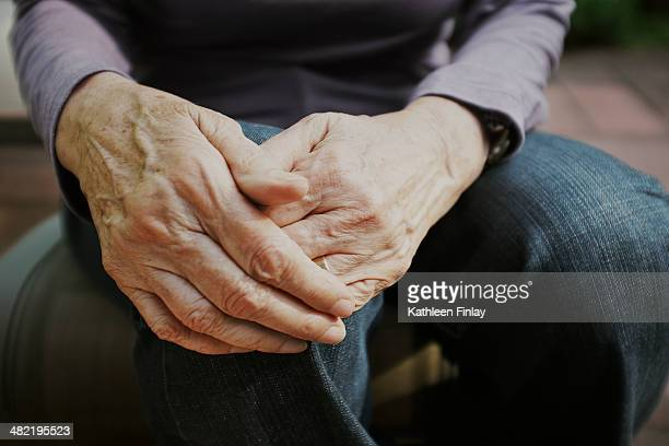 cropped shot of senior woman with hands on knee - hand on knee stock pictures, royalty-free photos & images