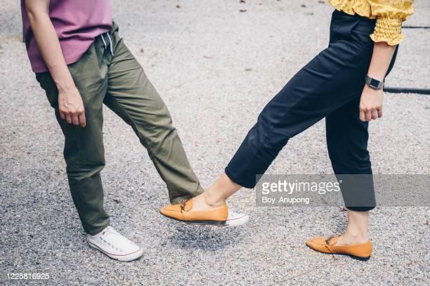 cropped shot of two woman foot tap for greeting during coronavirus epidemic. - nah stock-fotos und bilder