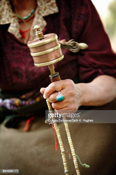 Cropped shot of woman holding prayer beads and bell, Dharamshala, Himachal Pradesh, India