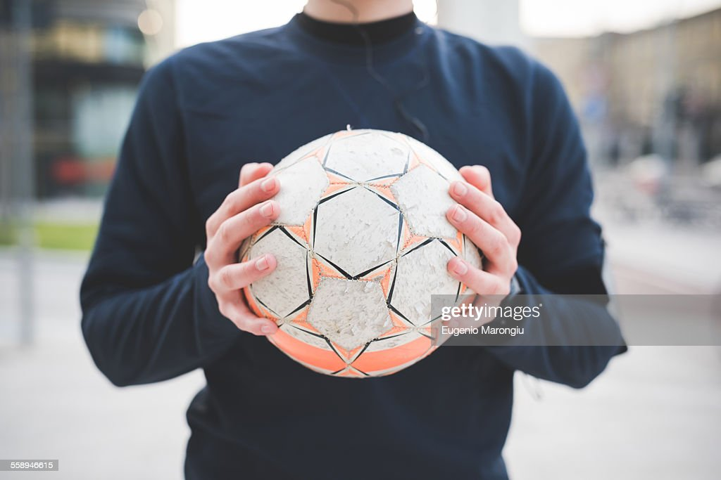 Cropped shot of young man holding soccer ball : ストックフォト