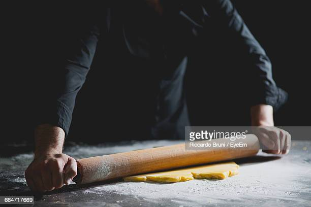 Cropped View Of Chef Rolling Pastry Dough