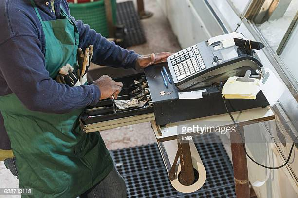 Cropped view of man using old cash register
