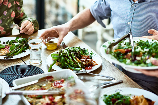 Cropped view of table laid with crockery and fresh homemade vegetarian food - gettyimageskorea