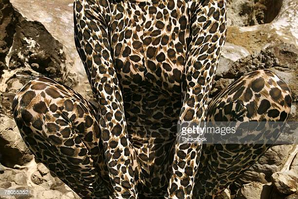 Cropped view of woman in leopard suit