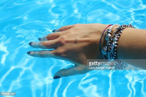 Cropped Woman Hand In Sea