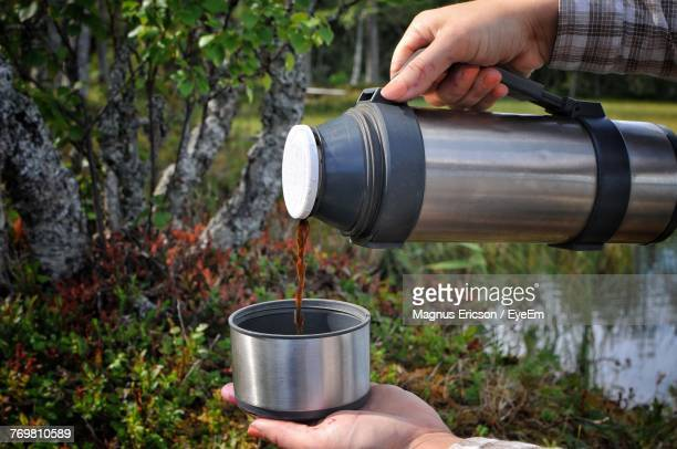 Cropped Woman Pouring Coffee From Insulated Drink Bottle