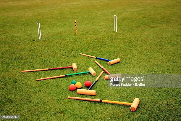Croquet Mallets And Balls On Field