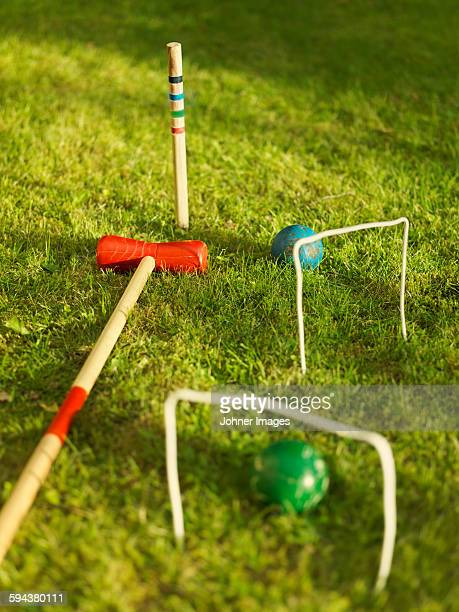 Croquet mallets and balls on lawn