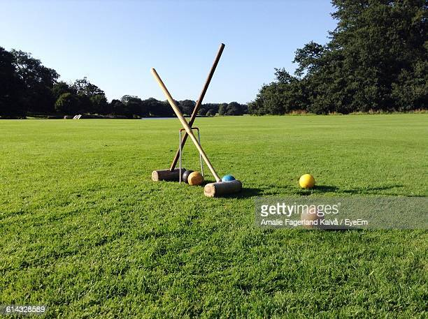 Croquet Set On Grassy Field Against Sky