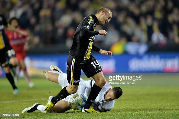 Cros Pierrick goalkeeper of Mouscron Peruwelz is first to the ball and beats Remacle Jordan forward of Sporting Lokeren during the Jupiler Pro League...