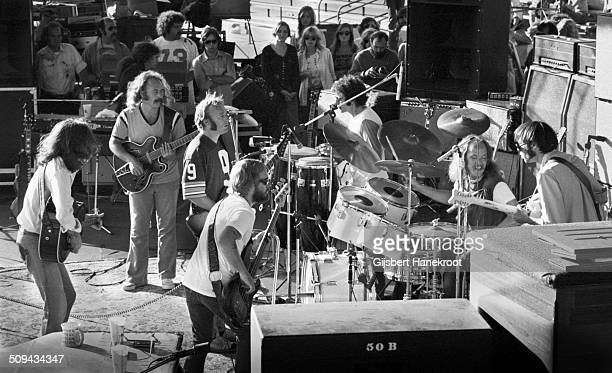 Crosby Stills Nash and Young perform live on stage at Oakland Colisseum California on July 14 1974 during their 1974 US Tour LR Graham Nash David...