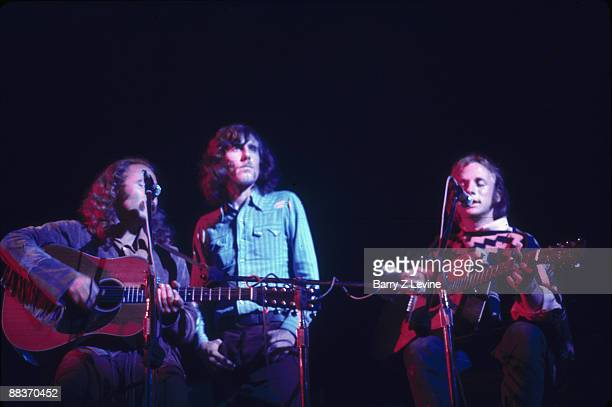 Crosby Stills Nash Young perform at the Woodstock Music and Arts Fair in Bethel New York August 18 1969 The group American musician David Crosby...
