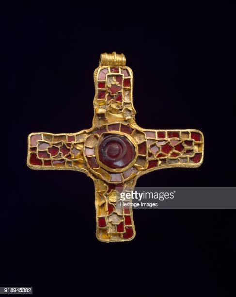 Cross 7th century Highstatus pectoral cross gold and cloisonne work inlaid with garnets an early example of the Christian symbol in AngloSaxon...