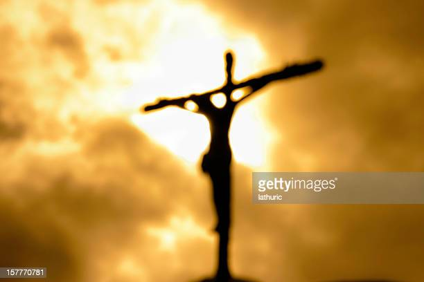 cross against a dark yet bright sky symbolizing forgiveness - crucifix stock pictures, royalty-free photos & images