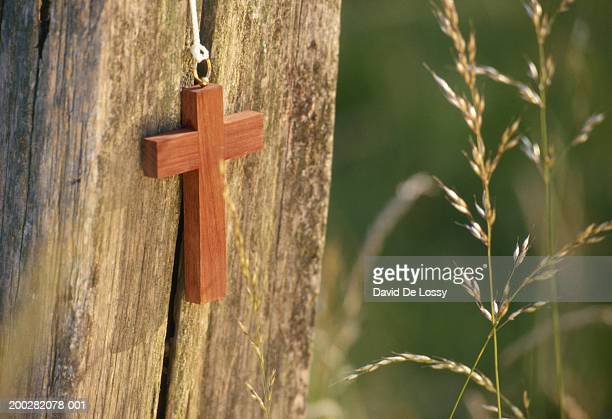 Cross against wood