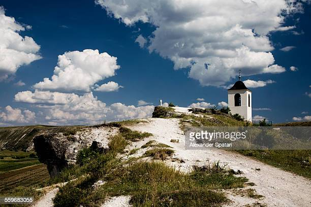 Cross and bell tower on a cliff in Orheiul Vechi