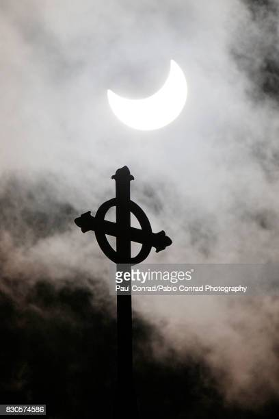 Cross and Eclipse