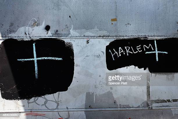 """Cross and the name """"Harlem"""" is drawn in chalk on a wall in an area where people smoke K2 or """"Spice"""", a synthetic marijuana drug, in East Harlem on..."""