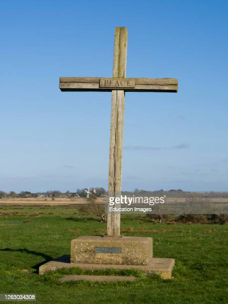 Cross at St Bennet's Abbey, Ludham, The Norfolk Broads, Norfolk, UK. Plaque at the bottom reads This cross of English Oak from Sandringham presented...
