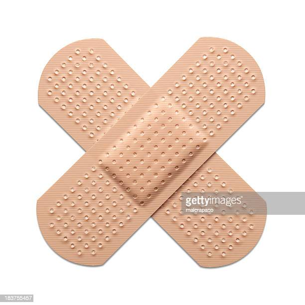 cross bandaid - bandage stock photos and pictures