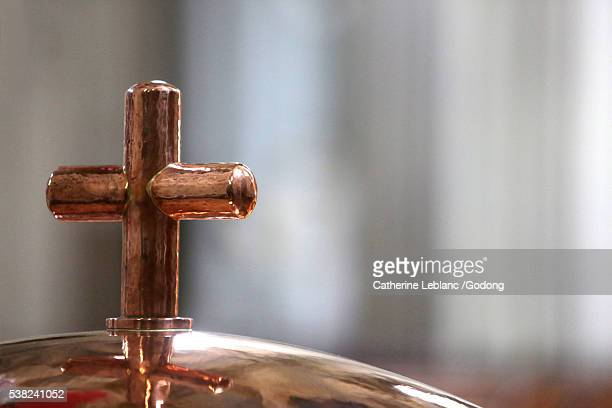 cross. baptistery. - sallanches stock pictures, royalty-free photos & images