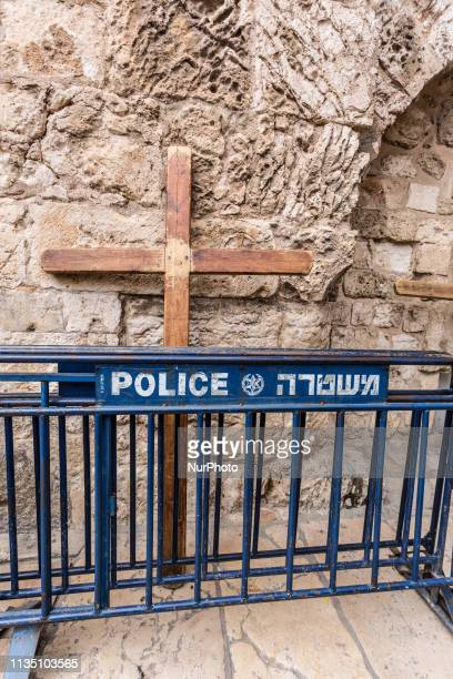 Cross behind police bar in front of the Church of the Holy Sepulchre in Jerusalem, Israel on April 5, 2019.