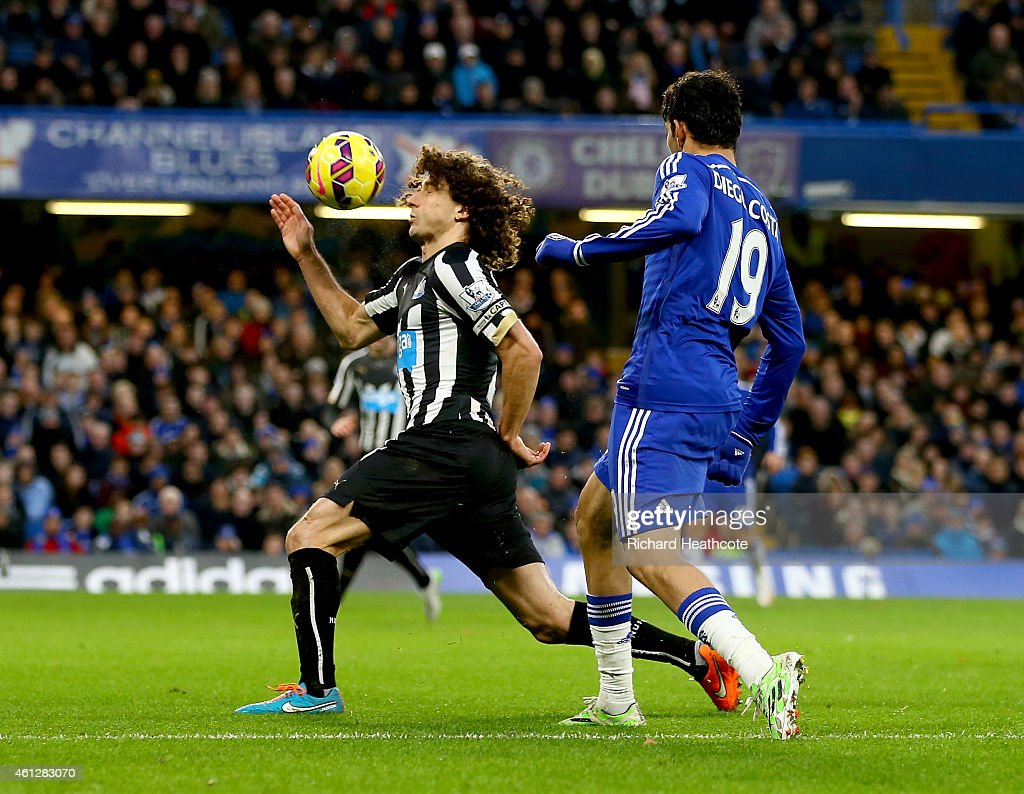 A cross by Diego Costa of Chelsea strikes Fabricio Coloccini of Newcastle on the arm during the Barclays Premier League match between Chelsea and Newcastle United at Stamford Bridge on January 10, 2015 in London, England.