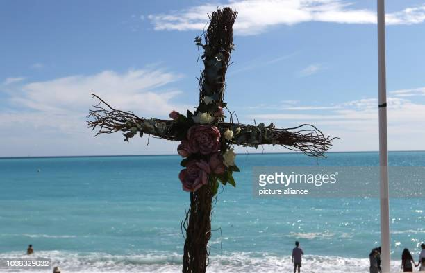 A cross can be seen on the 'Promenade des Anglais' in Nice France 14 September 2016 A 31yearold Tunisian man had driven into a crowd on the beach...
