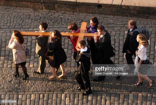 A cross carried by young people is brought to a reception at Edinburgh Castle that was attended by Scottish First Minister Alex Salmond and Cardinal...