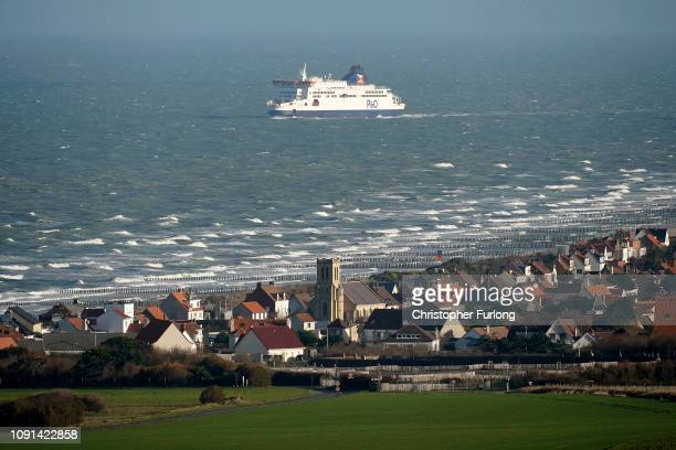Cross channel ferry passes the town of Sangatte, where it is believed that migrants could launch boats to cross the English Channel on January 08,...